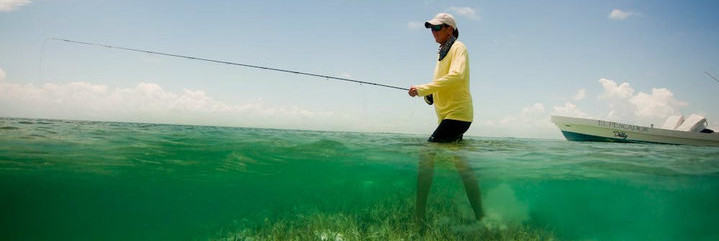 Lori-Ann wade fishing in Belize